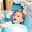 Little girl visiting dentist — Foto Stock