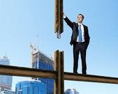 Businessman standing on the construction site — Stock Photo