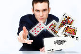 Young man showing poker cards — Stok fotoğraf