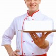 Cook holding an empty tray — Stock Photo