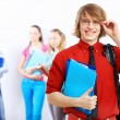 Student in red shirt with books — Stock Photo #12359739