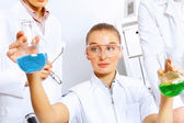 Young female scientist working in laboratory — Fotografia Stock