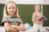 Little girl at school class — Stock Photo