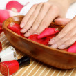 Woman is getting manicure — Stock Photo #12360094