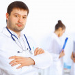 Young male doctor in white uniform — Stock Photo