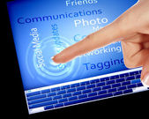 Finger touching a blue computer screen — Stock Photo