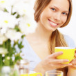 Beautiful young woman drinking tea — Stock Photo