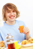 Young man drinking juice — Stock Photo