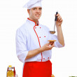Young cook preparing food — Stock Photo