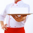 Cook holding an empty tray — Stock Photo #12392056