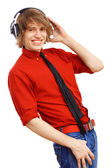 Happy smiling young man dancing — Stock Photo