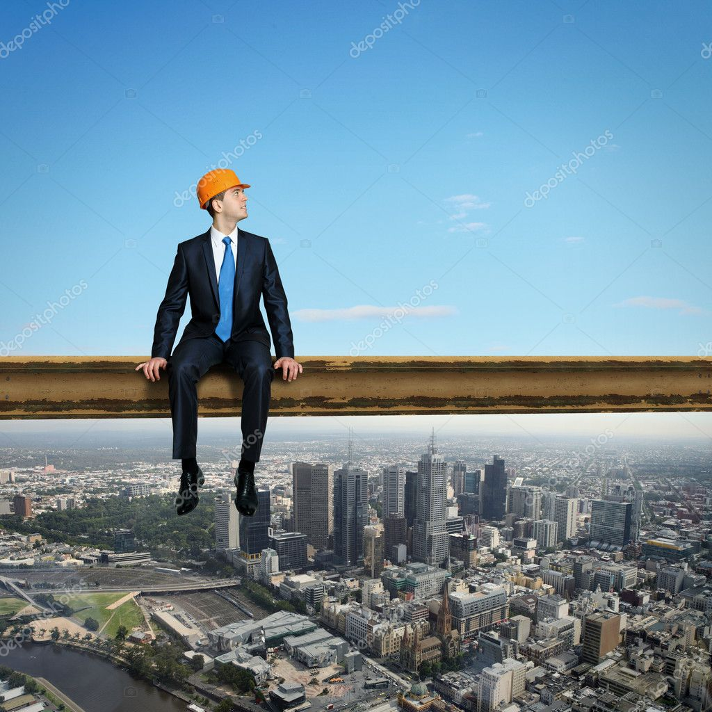 Business man standing high over a cityscape  — Stock Photo #12391889