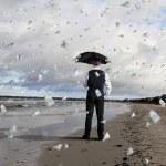 Business person under money rain — Stock Photo #12412090