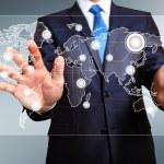 Businessman pressing social media icon — Stock Photo