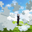 Businessman with a puzzle pieces — Stock Photo