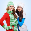 Two girls in winter hats and scarfs — Stock Photo