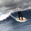 Young business person surfing on the waves — Stock Photo #12412421