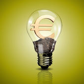 Electric light bulb and currency symbol inside it — Stock Photo