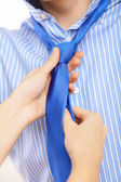 Businessman dressing at home in the morning — Stock Photo