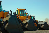 Tractor in a row — Stock Photo