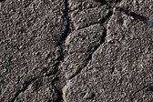 Broken asphalt background — Stock Photo