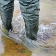 Man`s foot in rubber boots. — Stock Photo #11007645