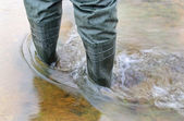 Man`s foot in rubber boots. — Stock Photo