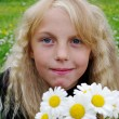 Girl with daisy. — Stock Photo #11131709
