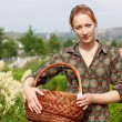 Girl in jeans shorts with basket — Stock Photo