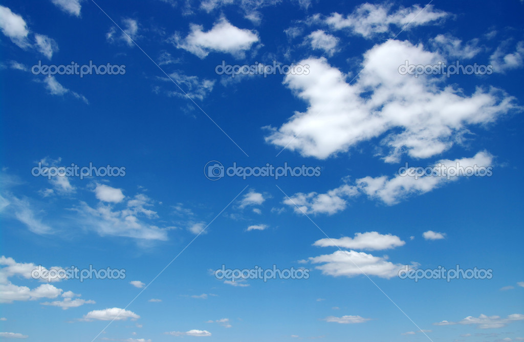 White fluffy clouds in the blue sky — Stock Photo #11371854