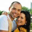 Closeup portrait of smiling young couple in love - Outdoors — Stock Photo
