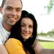 Closeup portrait of smiling young couple in love - Outdoors — Stock Photo #12171894