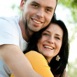 Stock Photo: Closeup portrait of smiling young couple in love - Outdoors
