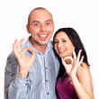 Closeup of good looking young couple gesturing okay sign over wh — Stock Photo