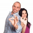 Man and woman smiling and showing you OK sign — Stock Photo #12173344