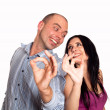 Man and woman smiling and showing you OK sign — Stock Photo #12173357