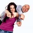 Portrait of happy young couple pointing at you over white backgr — Stock Photo #12173481
