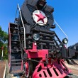 Old steam locomotive with red star — Stock Photo #10785082