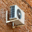 Air conditioner on old brick wall — Stock Photo