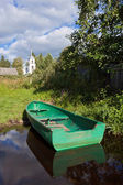 Summer's Russian lake scenery with wooden boat — Stock Photo