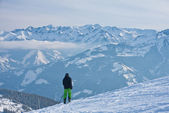 Alpine skier mountains in the background — Stock Photo