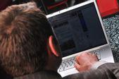 Man working on laptop — Stock Photo