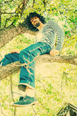 Portrait of handsome man on tree — ストック写真