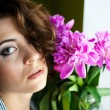 Beautiful young woman with peony flower — Stock Photo