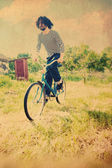 Handsome man on bicycle — 图库照片
