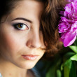 Beautiful woman with peonies — Stock Photo