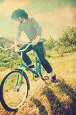 Handsome man on bicycle — Foto Stock