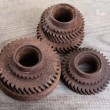 Rusty iron gear wheels on a  boards — Stockfoto