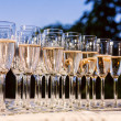 Champagne into glasses — Stock Photo #11138698