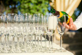 Champagne into glasses — Stock Photo